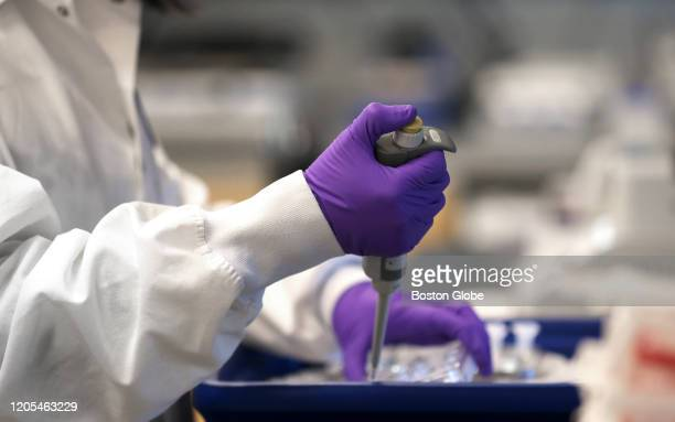 Scientist Xinhua Yan works in the lab at Moderna in Cambridge, MA on Feb. 28, 2020. Moderna has developed the first experimental coronavirus...