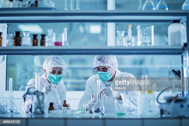 scientists analyzing chemical substances for a new research. - place of research stock pictures, royalty-free photos & images