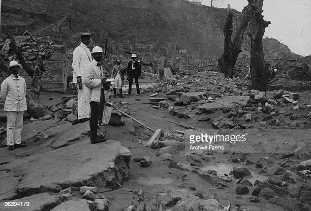 Scientists and naval officers explore the ruins of St Pierre after the eruption of the Mount Pelee volcano on May 10 1902 at St Pierre Martinique