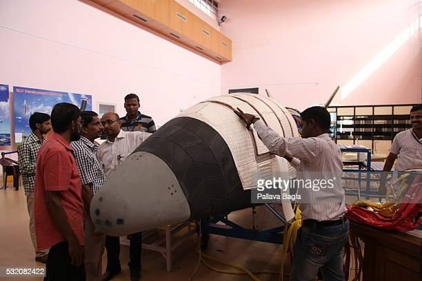 ISRO scientists and technicians work on India's first reusable Launch Vehicle or 'Space Shuttle' as it sits in a laboratory at Vikram Sarabhai Space...