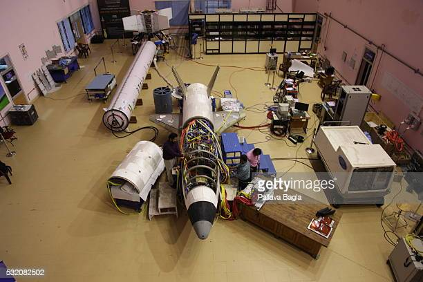 ISRO scientists and technicians work on India's first reusable Launch Vehicle or 'Space Shuttle' sits in a laboratory at Vikram Sarabhai Space Center...
