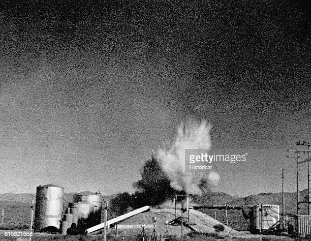Scientists at the National Reactor Testing Station created this explosion by removing the control rod from a nuclear reactor buried under the earthen...
