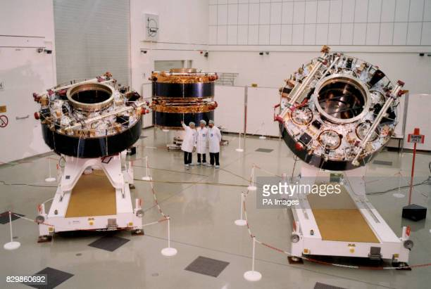 Scientists at the Rutherford Appleton Laboratory near Oxford with part of a flotilla of four space craft launched inside the European Space Agency's...