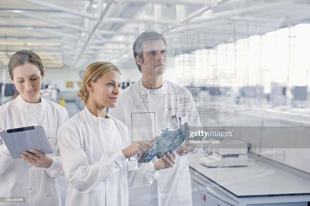 Scientists at work in lab : Stock Photo