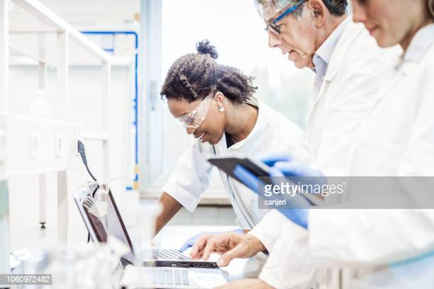 scientists discussing in the laboratory - medical clinic stock pictures, royalty-free photos & images