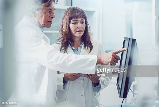 Scientists Discussing New Findings
