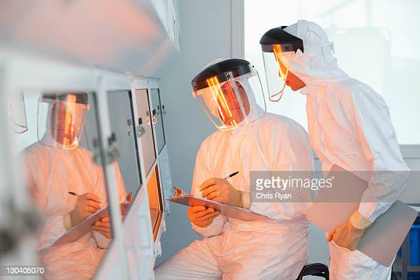 scientists examining oven in lab - hearing protection stock pictures, royalty-free photos & images