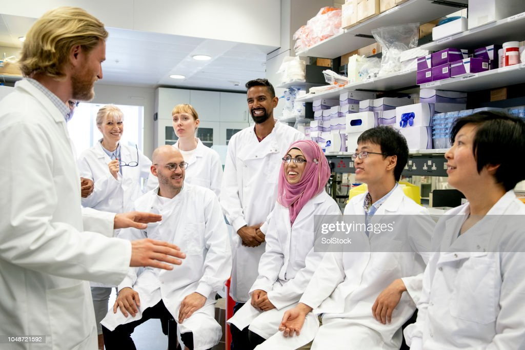 Scientists having a Meeting in the Laboratory : Stock Photo