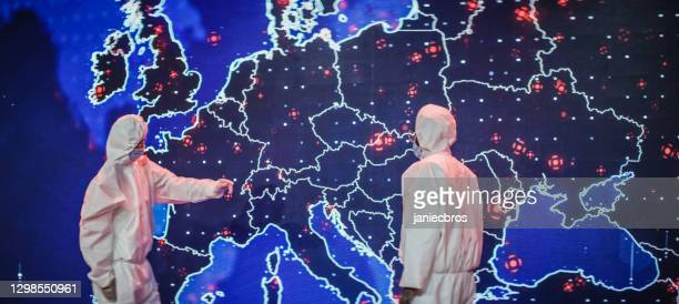 scientists in clean suits. infection map of europe projection. first outbreaks of disease - genetic mutation stock pictures, royalty-free photos & images