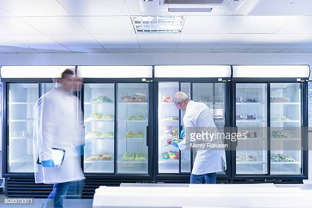 Scientists inspecting food for freshness in laboratory in food packaging printing factory