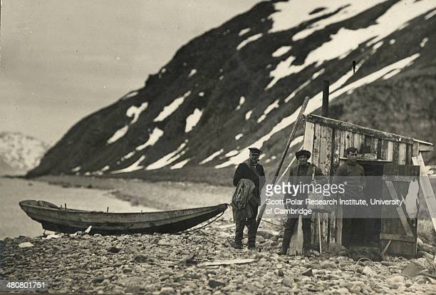 Scientists James Wordie Robert Clark and Reginald James outside Veslegard Hut in South Georgia 28th November 1914 during the Imperial TransAntarctic...