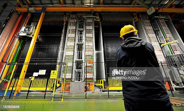 Scientists look at the Oscillation Project with Emulsion-Racking Apparatus detector at the Gran Sasso National Laboratory located under the Gran...