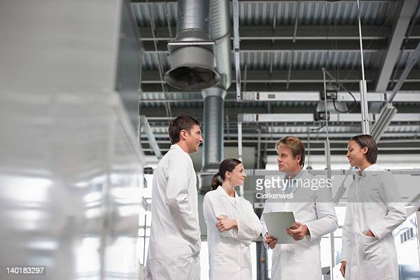 Scientists meeting in laboratory