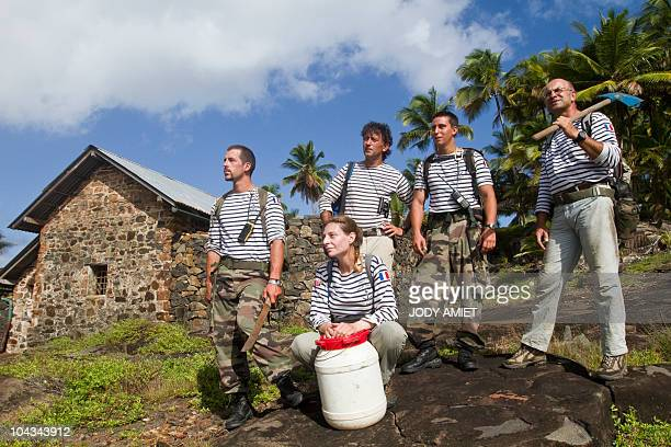 Scientists of the TerreOcean mission pose in front of the house where was the cell of Jewish French army captain Alfred Dreyfus on February 13 on the...