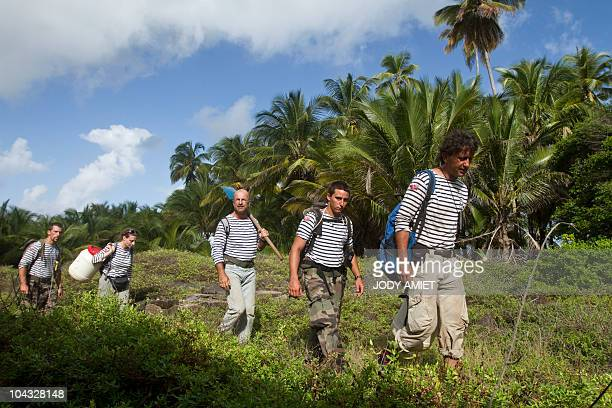 Scientists of the TerreOcean mission walk on February 13 on the Devil's Island in the Caribbean Sea off French Guiana about 10 miles from Kourou On...