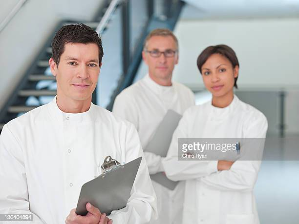 Scientists standing together in office