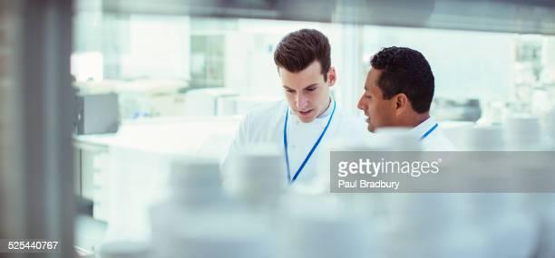 Scientists talking in laboratory