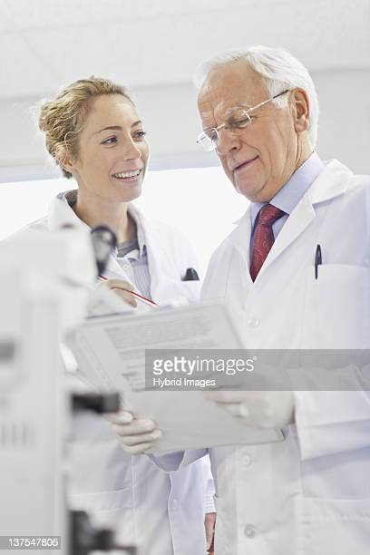 Scientists talking in pathology lab