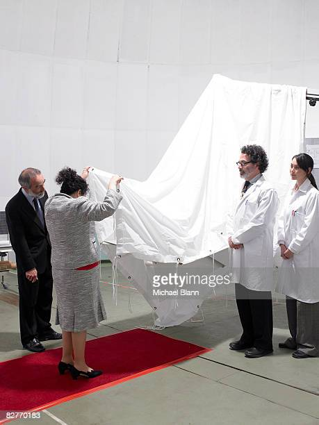 scientists unveil invention to dignitaries - opening ceremony stock pictures, royalty-free photos & images