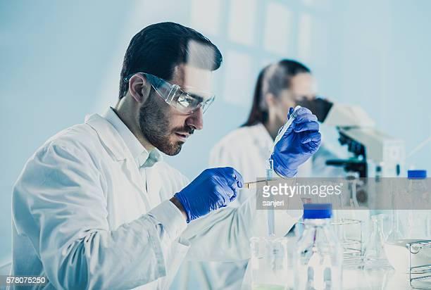 Scientists Using Lab Glassware