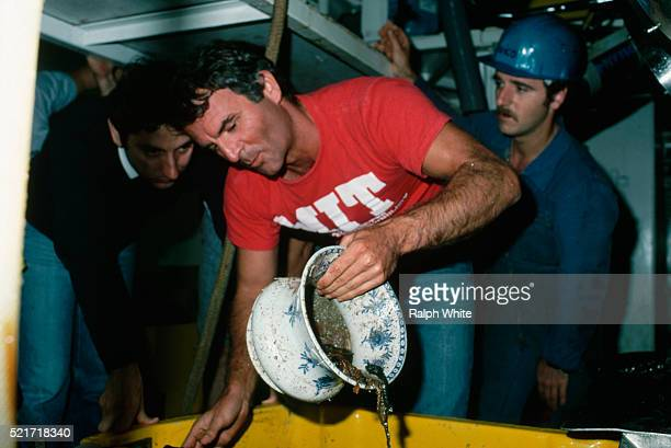 scientists with chamber pot from titanic shipwreck - titanic stock pictures, royalty-free photos & images
