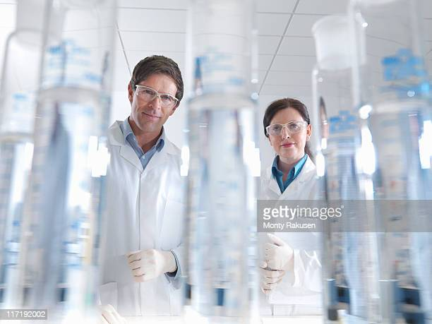 Scientists with laboratory equipment