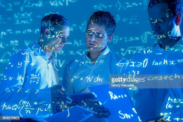 Scientists with projected mathematical data