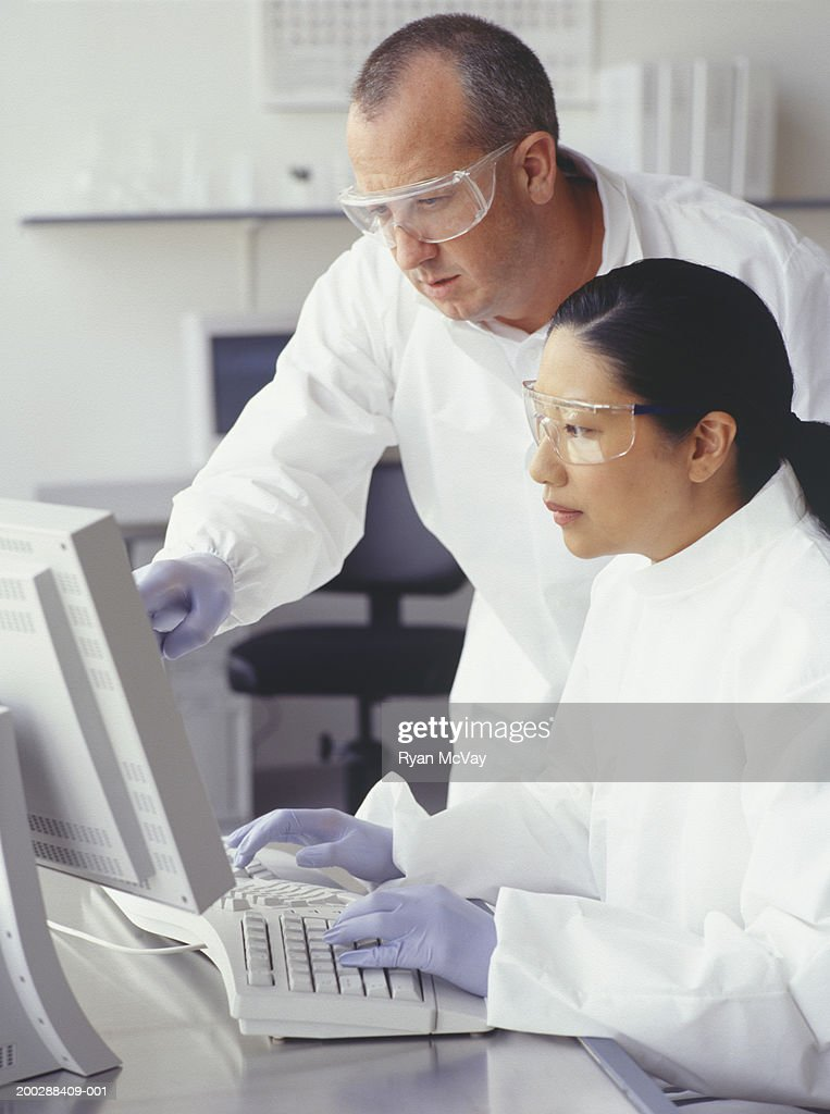 Scientists working at computer : Stock Photo