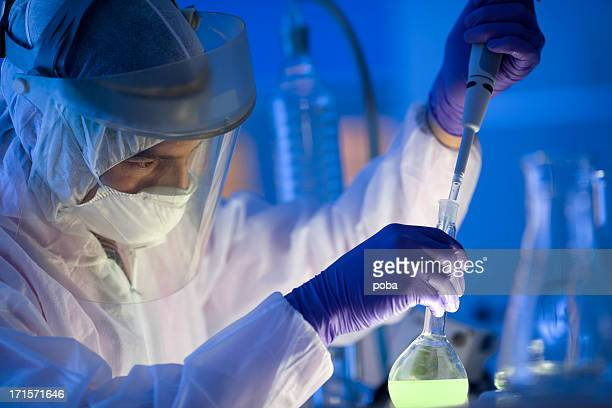 scientists working at the laboratory examining hazardous chemicals