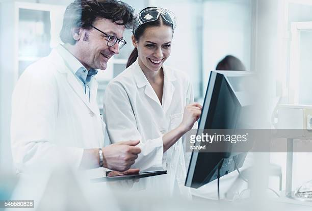 scientists working at the laboratory - soft focus stock pictures, royalty-free photos & images