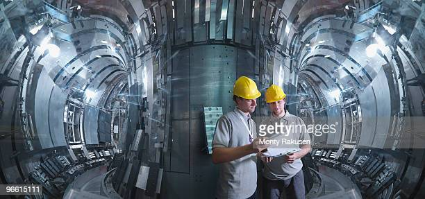 Scientists Working In A Fusion Reactor