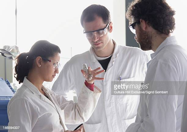 Scientists working in chemistry lab
