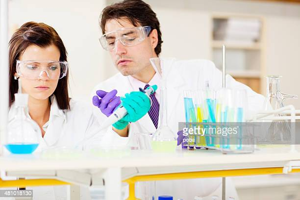 scientists working in  laboratory