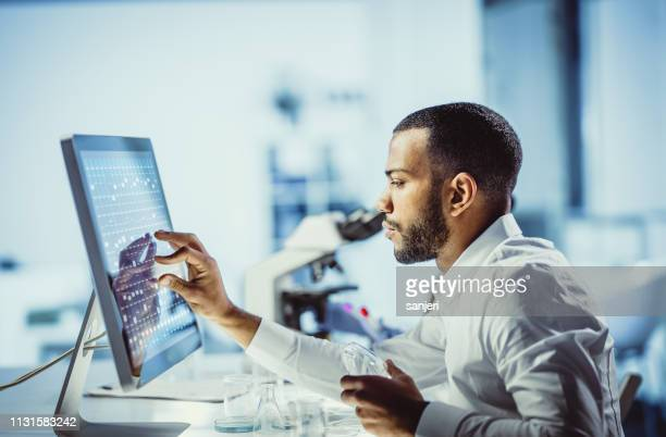 scientists working in the laboratory, using touch screen - touch sensitive stock pictures, royalty-free photos & images