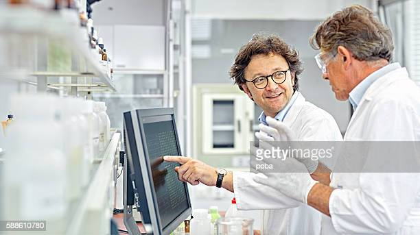 Scientists working on computer in a lab
