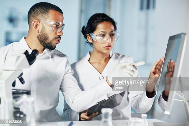 scientists working on computer in  modern laboratory - hd stock pictures, royalty-free photos & images
