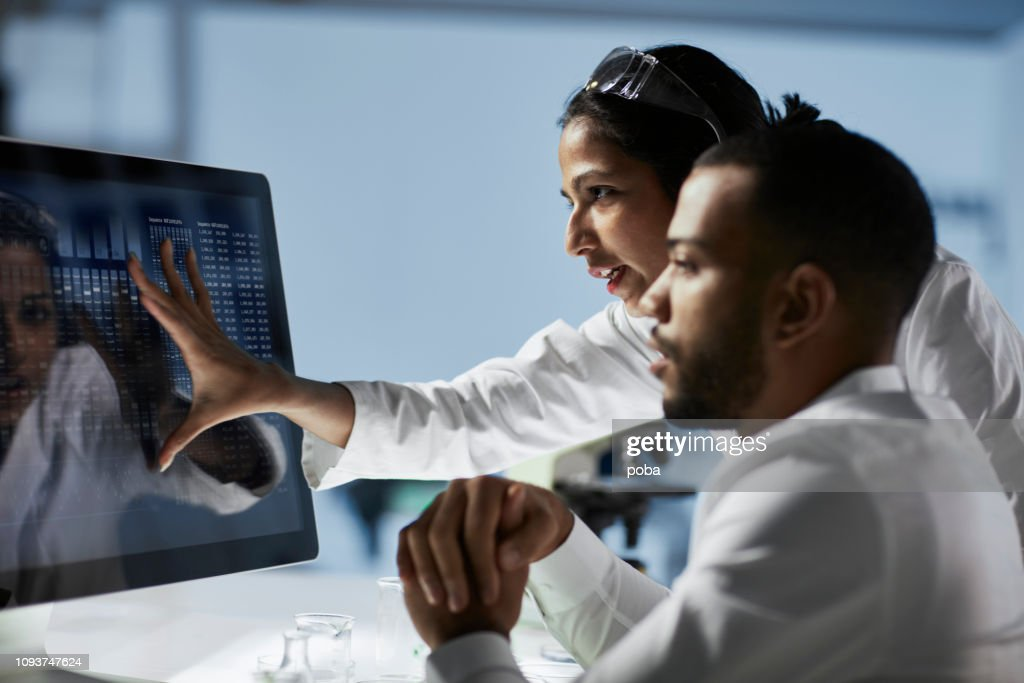 Scientists Working on Computer In  Modern Laboratory : Stock Photo
