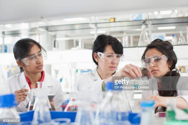 Scientists working together in lab