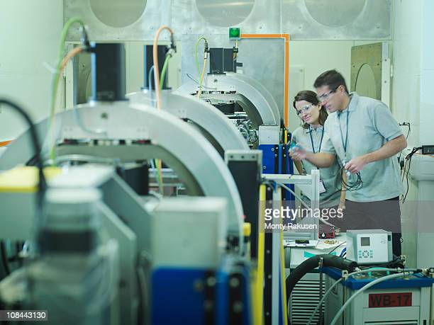Scientists working with particle accelerator