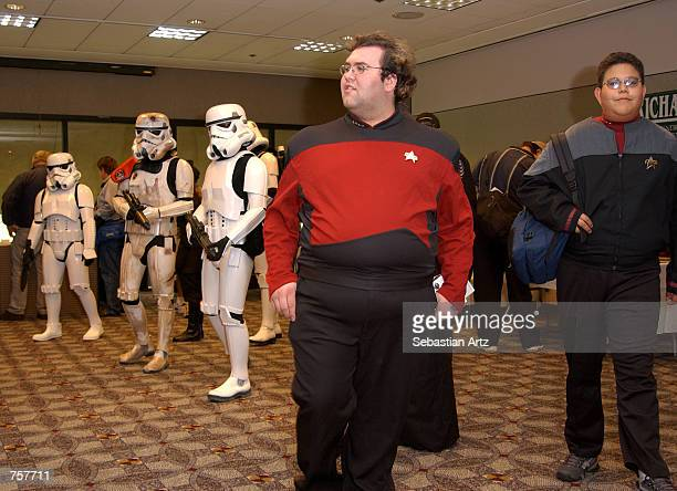 Scifi fans in Star Trek and Star Wars costumes attend the Star Trek Grand Slam Show X March 23 2002 in Pasadena CA