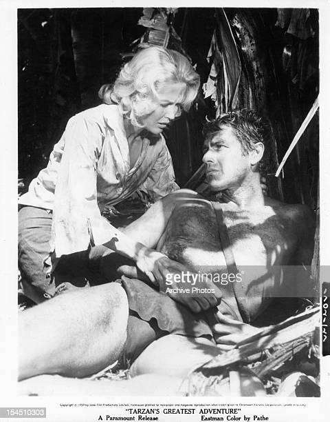 Scilla Gabel takes care of Gordon Scott in a scene from the film 'Tarzan's Greatest Adventure' 1959