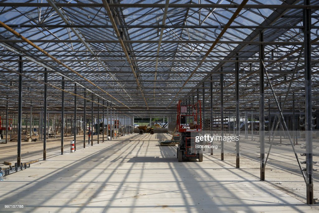 A scissor lift is seen in a greenhouse under construction at the CannTrust Holding Inc. Niagara Perpetual Harvest facility in Pelham, Ontario, Canada, on Wednesday, July 11, 2018. Canadian pot stocks have had a wild ride in the past year with the BI Canada Cannabis Competitive Peers Index surging about 250 percent from October to December as the road to legalization became clearer in Canada, before dropping by about 36 percent this year. Photographer: Cole Burston/Bloomberg via Getty Images