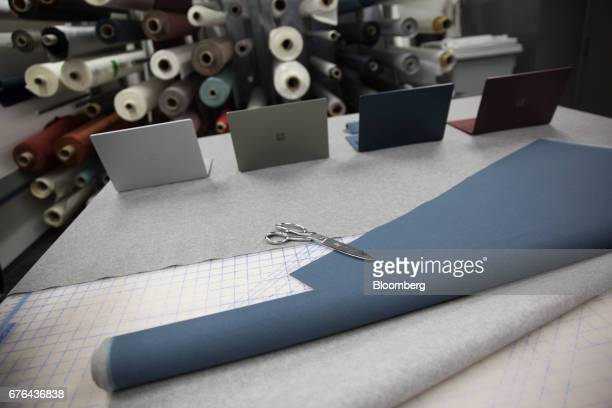 Scissors and fabric sit on a table in front of new Surface Laptop computers displayed at the hardware lab of the Microsoft Corp. Main campus in...