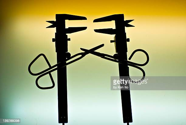 scissors and nut tool - ken ilio stock pictures, royalty-free photos & images