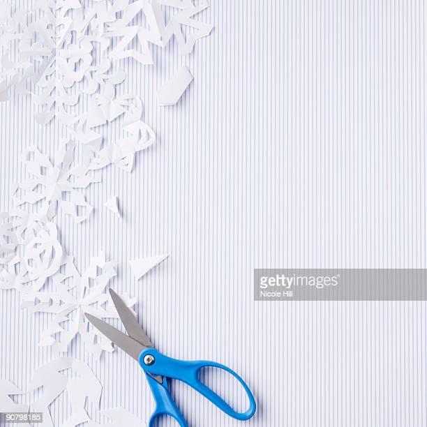 scissors and paper snowflakes