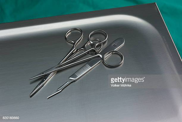 Scissors and Scalpel on Tray