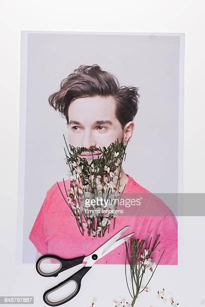 Scissors cutting beard made of flower and grass