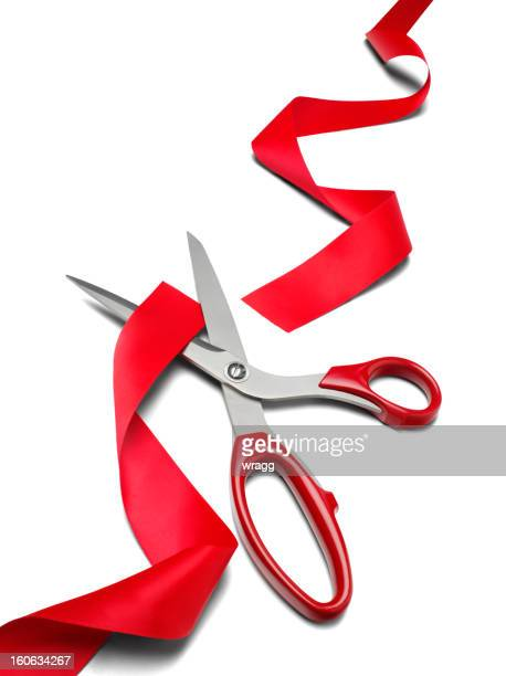 scissors cutting red ribbon - opening ceremony stock photos and pictures