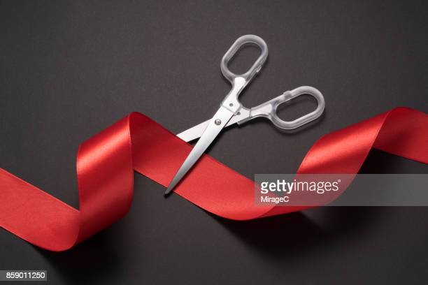 Scissors Cutting Red Ribbon