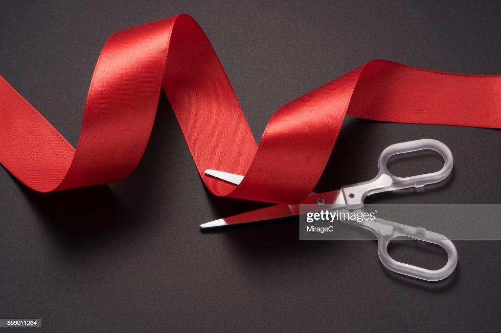 Scissors Cutting Red Ribbon : Stock Photo